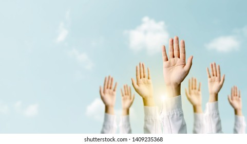 Group of hand businessmen raised the sky with sunlight. International volunteer day and human rights day. People voted concept