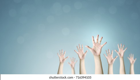 Group of hand raise up many people community service, International volunteer day and human rights day concept