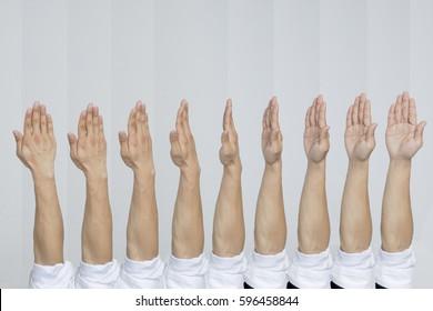 A group of hand turning his hand with white shirt , isolated