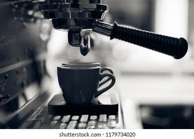 group handle of espresso machine ready to brew coffee, dark tone