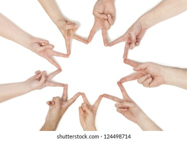 Group of hands forming a star shape isolated in a white background