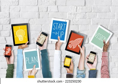 Group of Hands Holding Digital Devices with Startup Concept