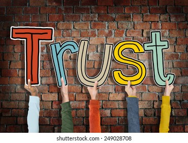 Group of Hands Holding Letter Trust