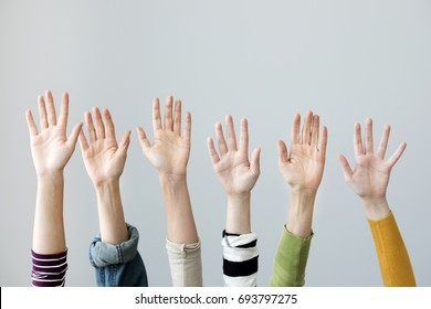 Group of hands raised