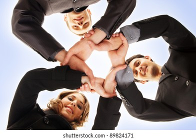 Group handshake with a lot of different hands over blue background