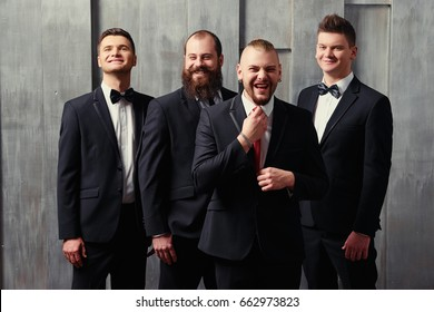 Group of handsome elegant young men in tuxedo.