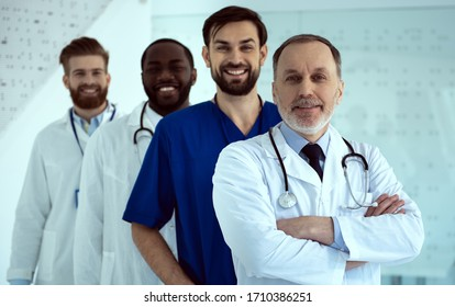 Group of handsome male doctors looking at camera and smiling stock photo
