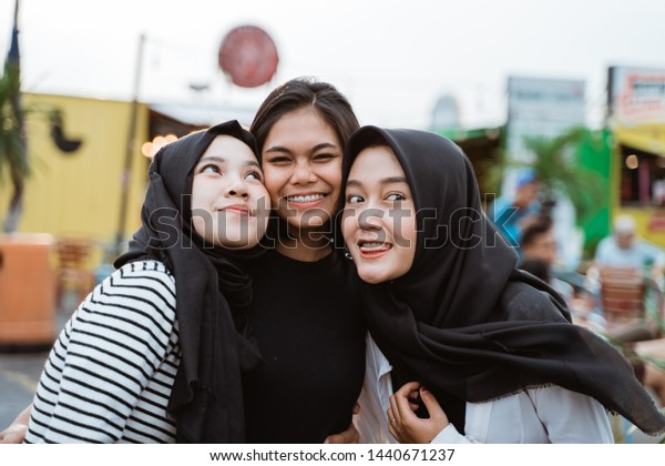 group of hanging out woman smiling look at camera