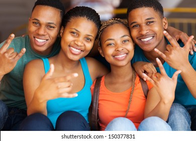 group of happy african college students giving cool hand signs