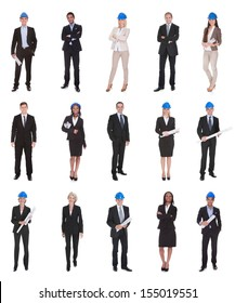 Group Of Happy Architects Holding Blue Print Over White Background