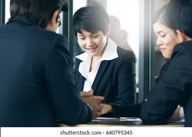 Group of happy asian business people. Asian business woman smile during conference in the office.