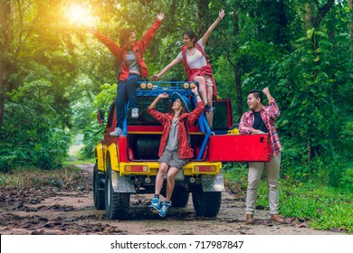 Group of happy asian young travellers on drive car off road in forest, travel and recreation concept.
