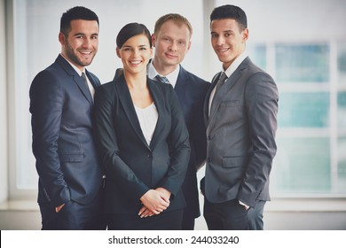 Group of happy business partners looking at camera