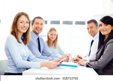 Group of happy business people at meeting