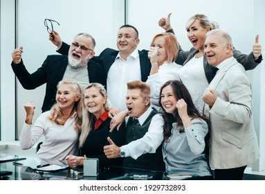 group of happy business people showing thumbs up