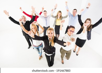 Group of a happy Business People standing together with raised arms.