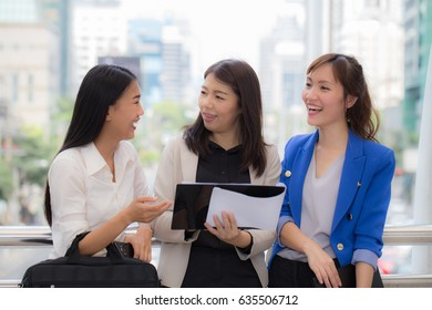 Group of happy business woman meeting outside office