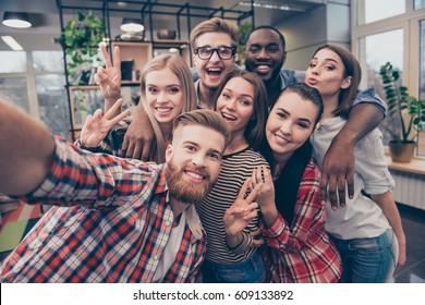 Group of happy cheerful best friends making selfie.
