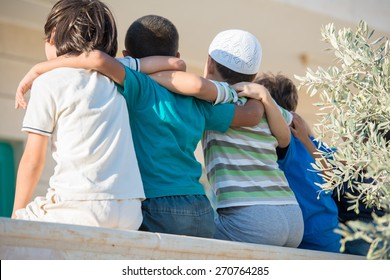 Group of happy children from back