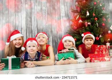Group of happy children in Christmas hat with presents