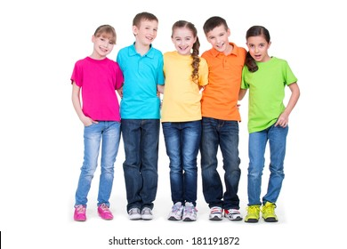 Group of happy children in colorful t-shirts standing together in full length on white background.