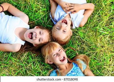 Group of happy children having fun outdoors.