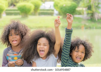 Group of happy children or kids playing outdoors. Kids having fun in the park.