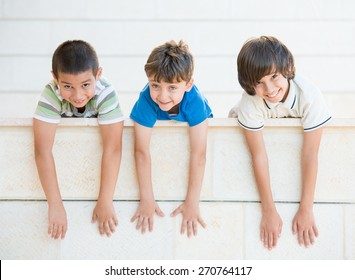 Group of happy children with open arms