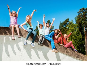 Group of happy children playing in park