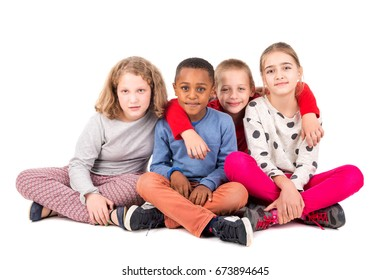 Group of happy children posing isolated in white