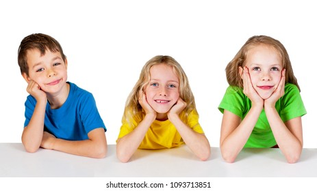 Group of happy children sitting at the table