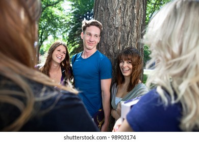 Group of happy college students having great time together