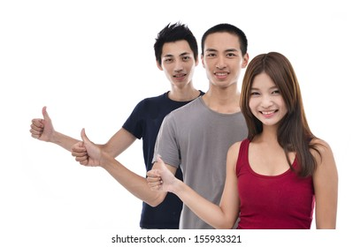 Group of happy college students showing thumbs up and looking at camera