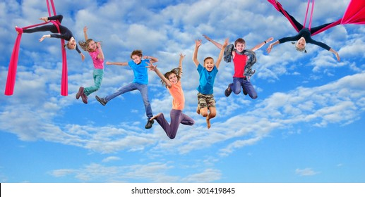 Group happy dancing jumping and aerial silks performing together children in blue sky. Photo collage. Childhood, active lifestyle, sports and happiness concept.