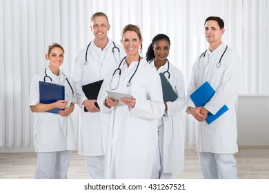 Group Of Happy Doctors And Nurses With Stethoscope