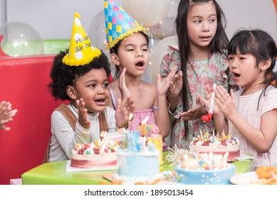 Group of  happy and enjoy kids have fun celebrating her birthday with Multinational friend kids birthday celebratiion party.