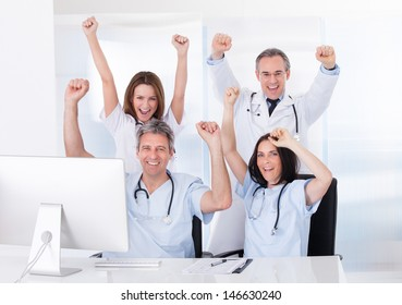 Group Of Happy Excited Doctor Raising Arm
