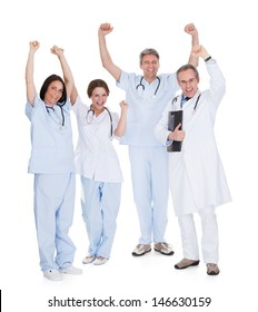 Group Of Happy Excited Doctors With Arm Raised Isolated Over White Background