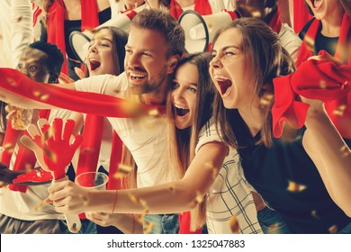 Group of happy fans are cheering for their team victory