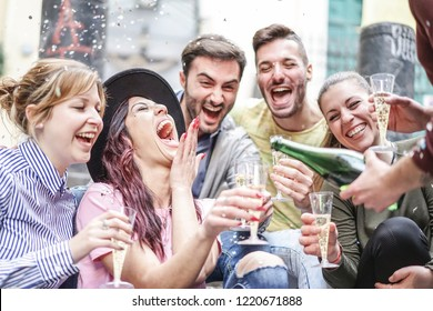Group of happy friends doing party throwing confetti and drinking champagne outdoor - Young people having fun celebrating birthday together - Friendship and youth holidays lifestyle concept