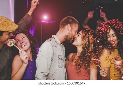 Group of happy friends doing party in nightclub - Young people having fun celebrating and dancing together in the disco club - Nightlife, entertainment and youth lifestyle holidays