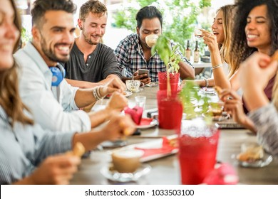 Group of happy friends drinking coffee and cappuccino at bar cafe - Young students people at breakfast eating and drinking hot beverage - Friendship and food concept - Focus on blond hair man face