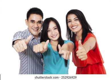 Group of happy friends giving thumbs up - at campus