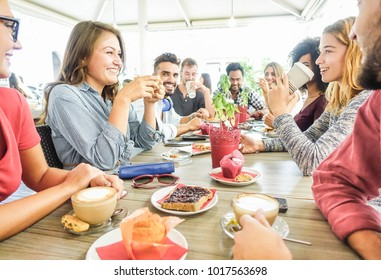 Group of happy friends having coffee break at bar cafeteria - Young students people enjoying breakfast - Friendship and good mood concept - Focus on left woman drinking cappuccino