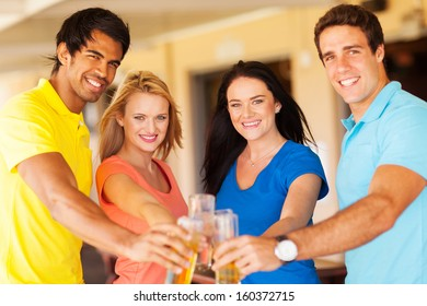 group of happy friends having drinks at a party