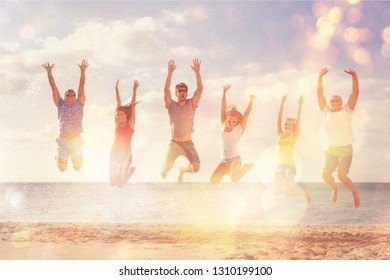 Group of happy friends having fun together on the beach
