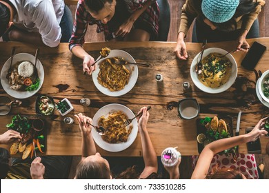 Group of happy friends having nice food and drinks, enjoying the party and communication, Top view of Family gathering together at home for eating dinner.