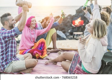 Group of happy friends making barbecue party dancing together - Adult surfer people listening music from speaker box and drinking beer - Focus on left man face - Fun, vacation and friendship concept