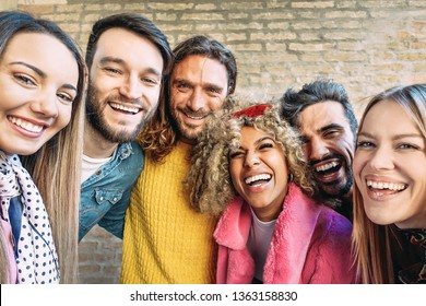 Group of happy friends taking selfie with mobile smartphone outdoor - Millennial young people having fun in the city center - Generation z, social media, tech and youth lifestyle concept