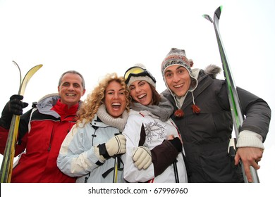 Group of happy friends in winter vacation